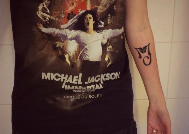Tatoeage Michael Jackson logo HIStory